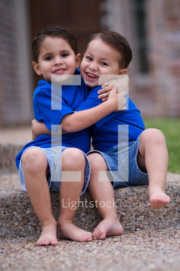 Young brothers hugging each other