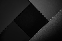 Minimal black texture background made of paper