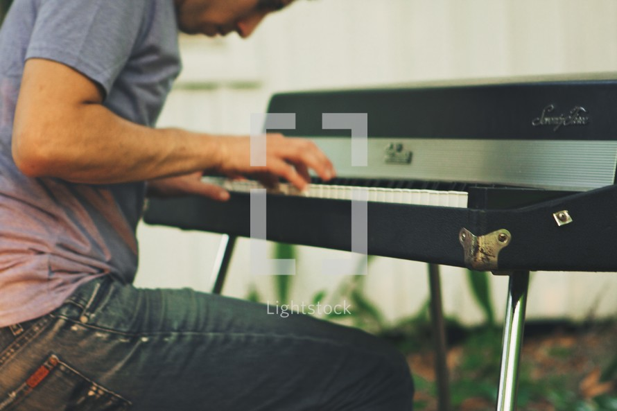 A man playing a keyboard.