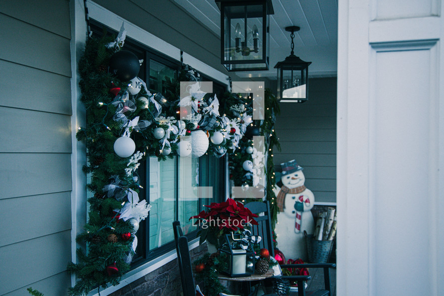 decorated front porch at Christmas