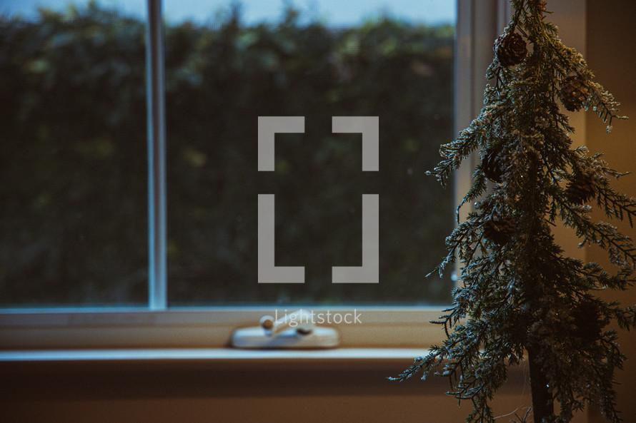 greenery beside a window at Christmas