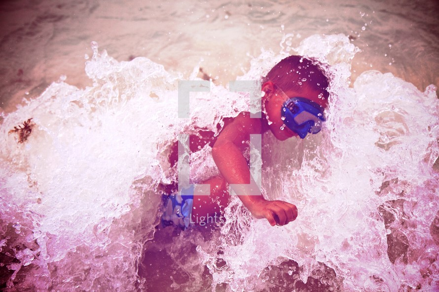 A boy splashing in the surf