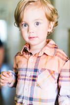 a bright eyed little boy
