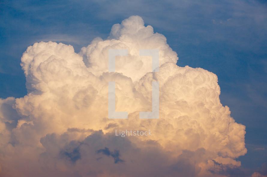 Cumulonimbus clouds in a blue sky.