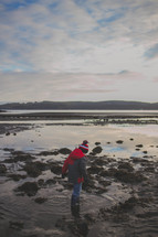 child walking in a tide pool
