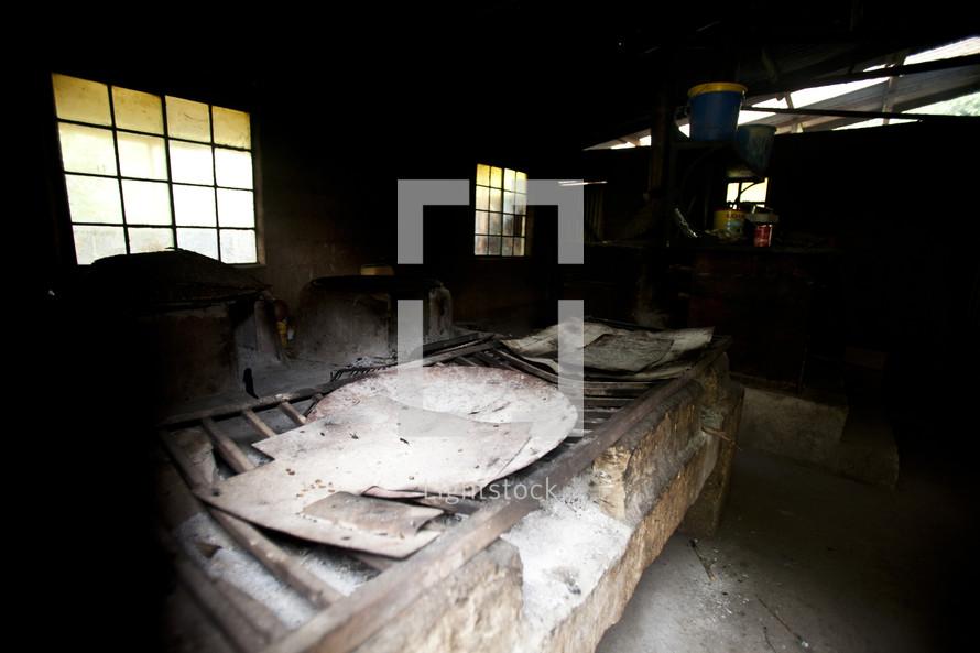A primitive fire pit inside a warehouse