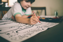 boy child coloring with crayons