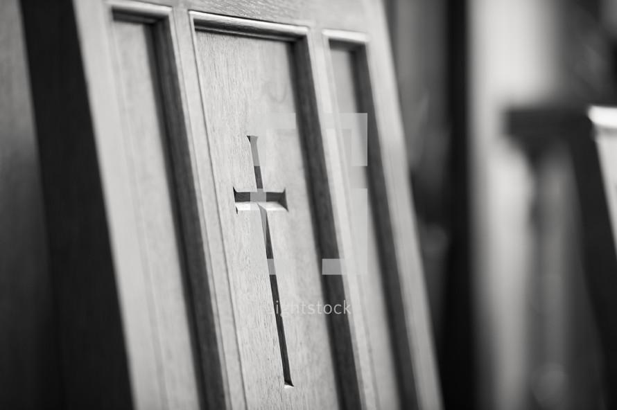 Cross inscribed in wood door