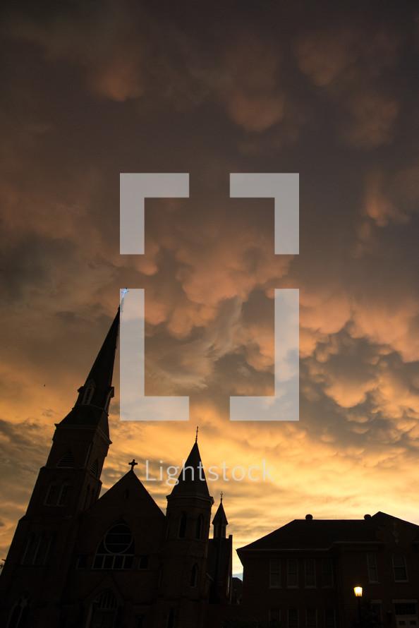 cross glowing on a church steeple