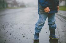 boy child in rain boots