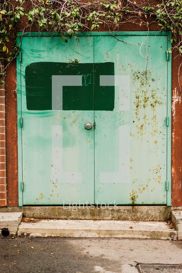 green steel doors