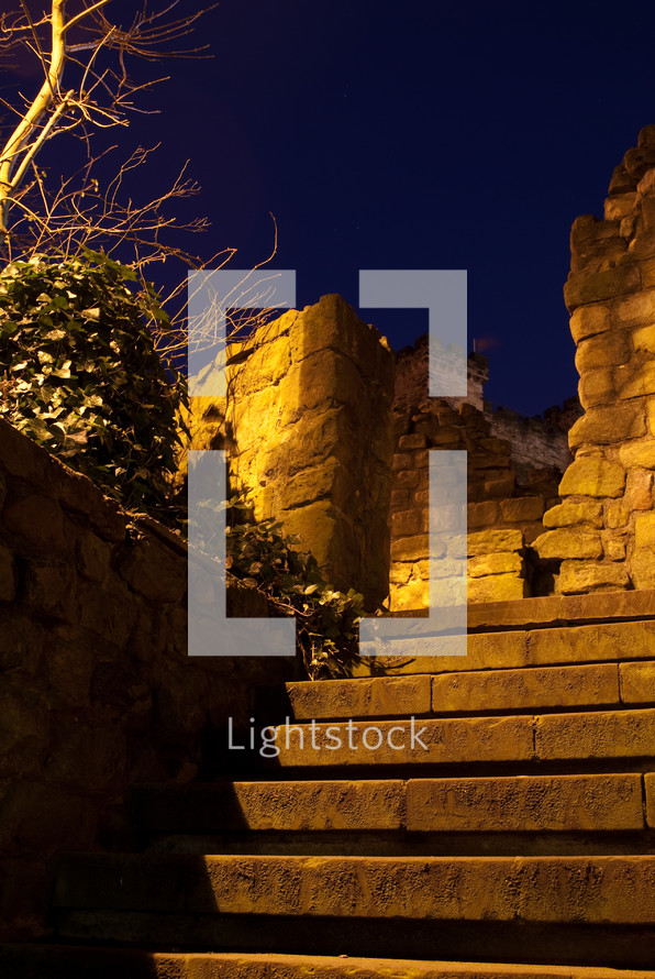 stairs leading to a collapsed stone wall