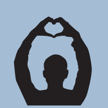silhouette of a man making a heart shape with his hands