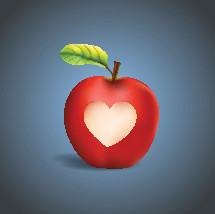 Red apple with a carved heart shape.