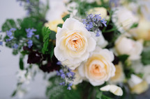 white roses and tiny blue flowers