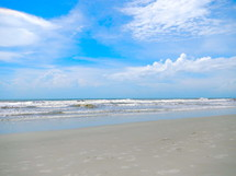 ocean waves and sandy beach