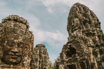 Faces carved in stone in a temple in Cambodia.