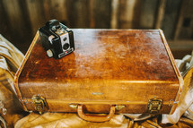 antique box camera and suitcase