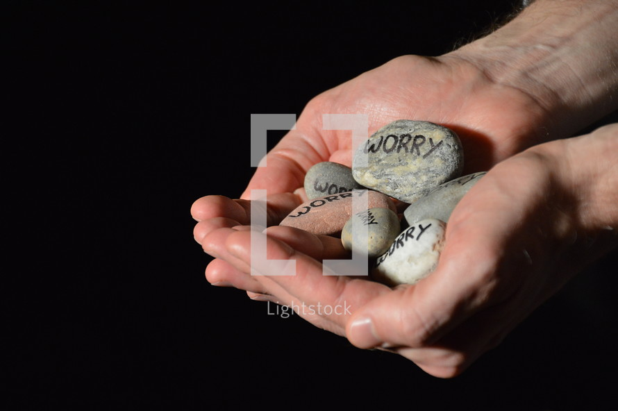 Jesus cares for our worries and his hands are holding our worries in the symbols of stones. 