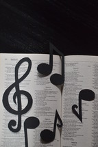 Bible open to Psalm 23 with notes and clef.  Psalm 23, bible, psalms, psalm, clef, notes, 23, twenty three, song, Psalms, sheet music, musical score, musical, score, music, play, worship, praise, praising, adore, proclaim, worshiping, playing, sing, singing, songs, band, make, making, audio, melody, tune, lyrics, song of songs, audible, hear, hearing, sonic, listen, listening, instrument, acoustic, classical, old, old testament, testament, ballads, celebrate, black, white