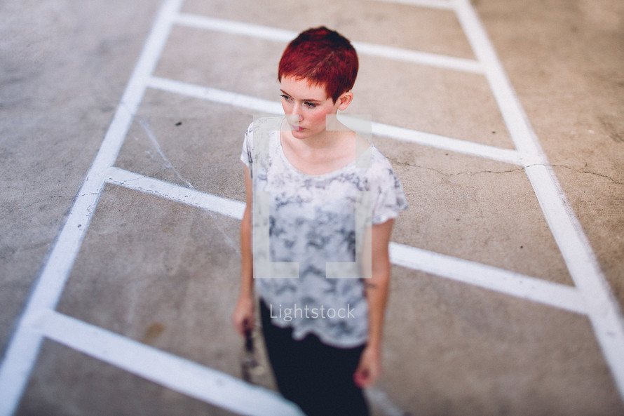 woman standing in a parking lot