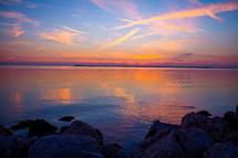 Sunset reflecting on a lake.