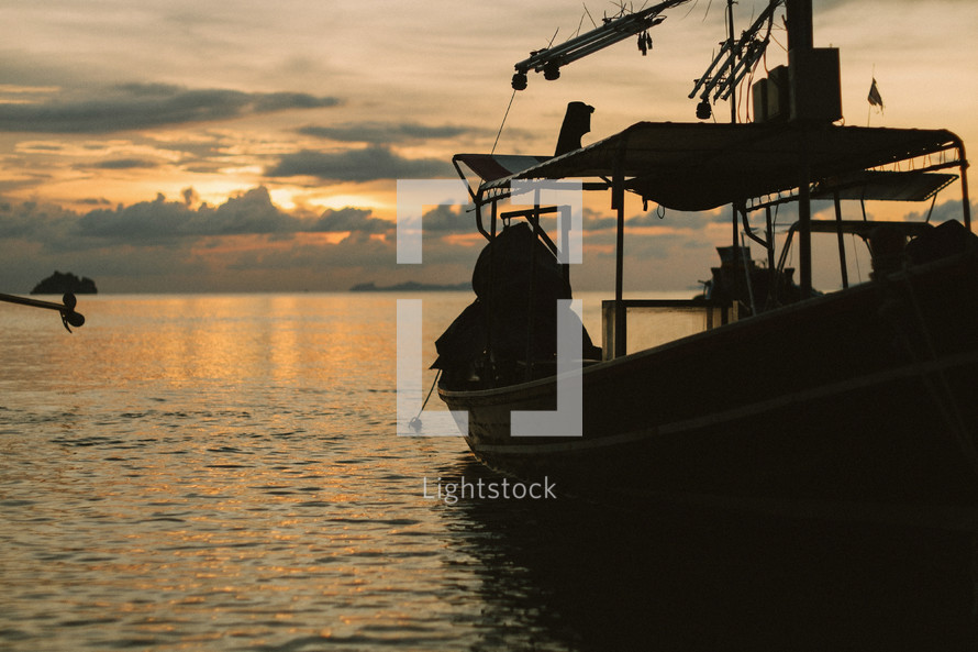 A fishing boat on the water at dusk.
