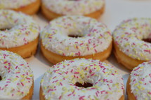 sugarcoated donuts with colorful sprinkles