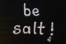 """The words, """"be salt,"""" written with salt on a table."""