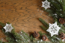 star ornaments, pine cones, and pine boughs