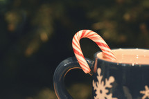 candy cane in a mug of hot cocoa