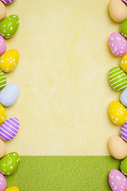 Easter egg border on yellow and green