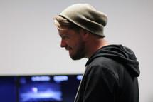 side profile of a man in wool cap