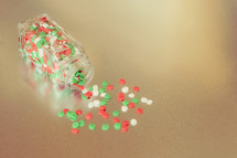 red, green, and white Christmas sprinkles