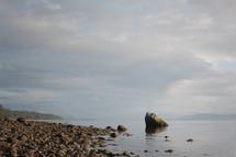 A rocky beach on the ocean.