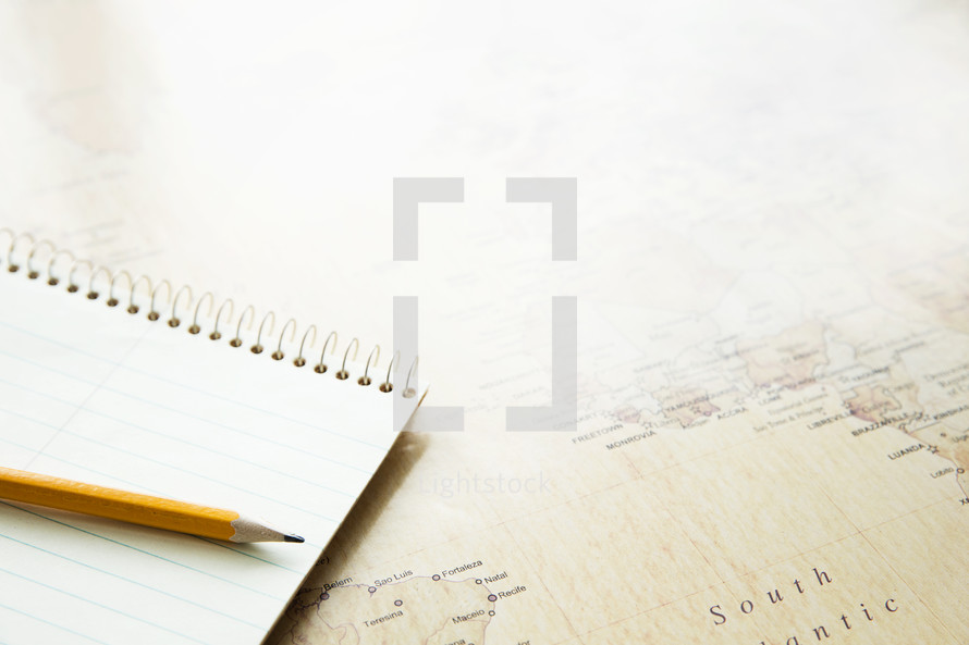 notebook, pencil, and map