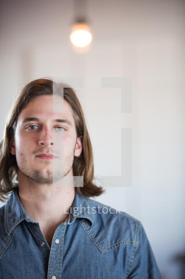 man straight faced staring at the camera