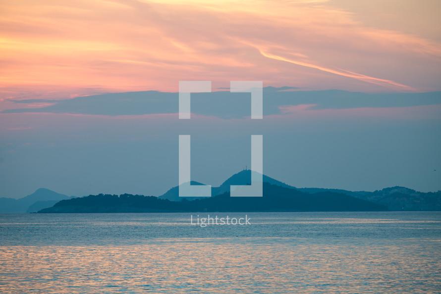 mountainous islands at sunset