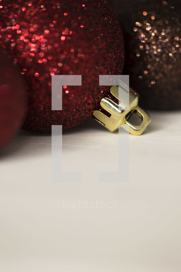 glittery Christmas ornaments on a white background