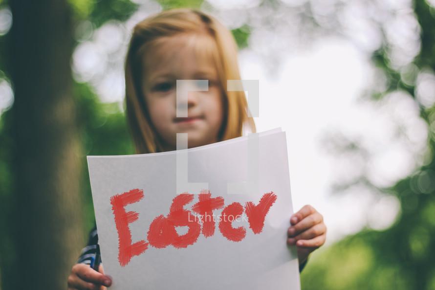 girl holding Easter sign