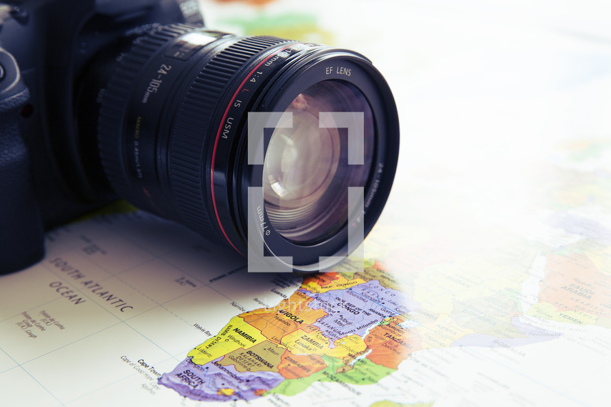 camera with lens on a map of Africa