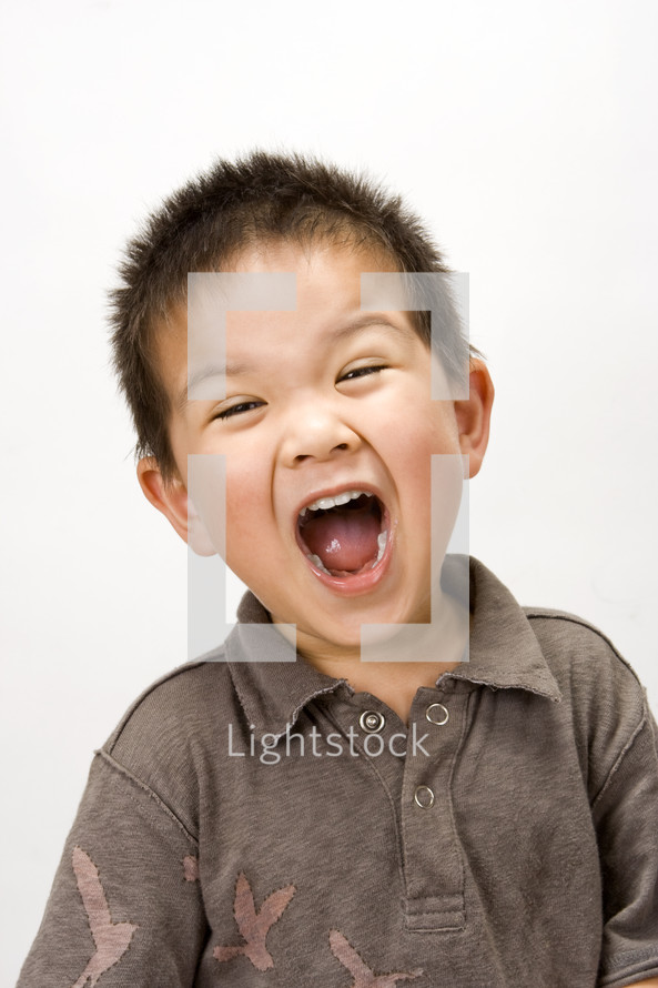 A toddler boy yelling
