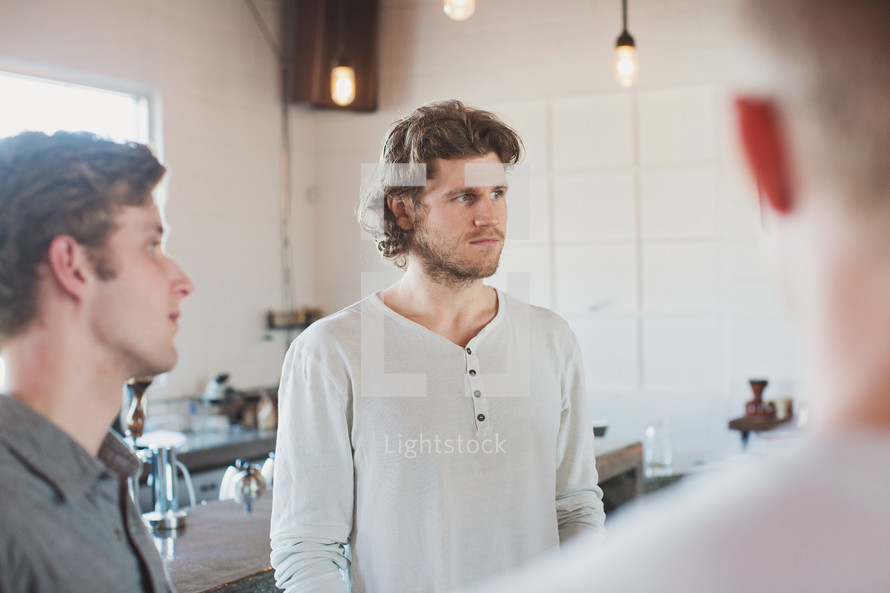 men gathered at a Coffee shop