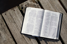 open Bible on a dock
