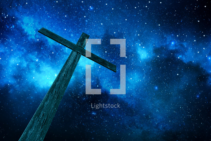 cross under stars in the night sky