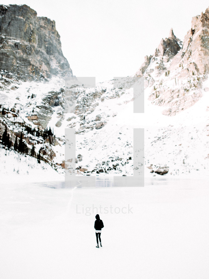 woman standing in a snow covered valley