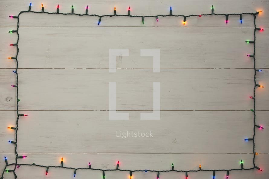 colored Christmas lights border.