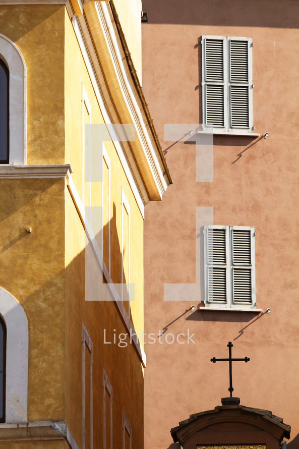 buildings in  Italy and cross on an arched church door