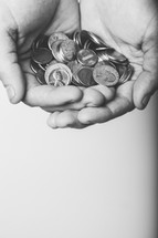 cupped hands holding coins
