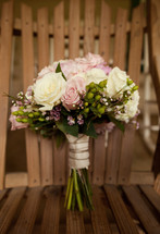 bridal bouquet resting on a chair